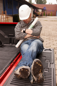 Man sleeping at work on his tailgate