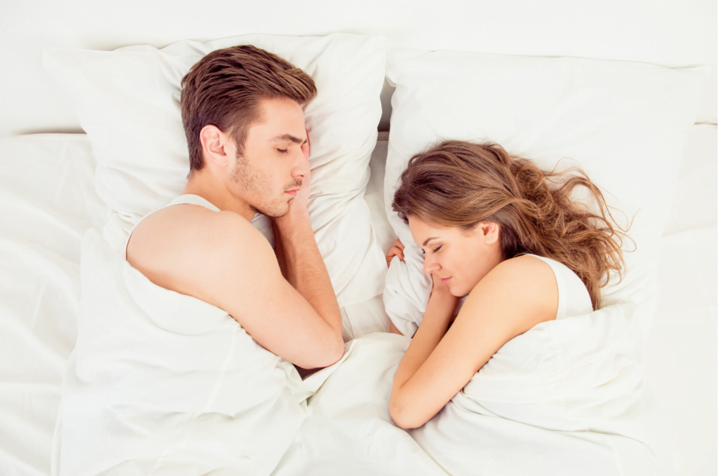 A man and a woman sleeping